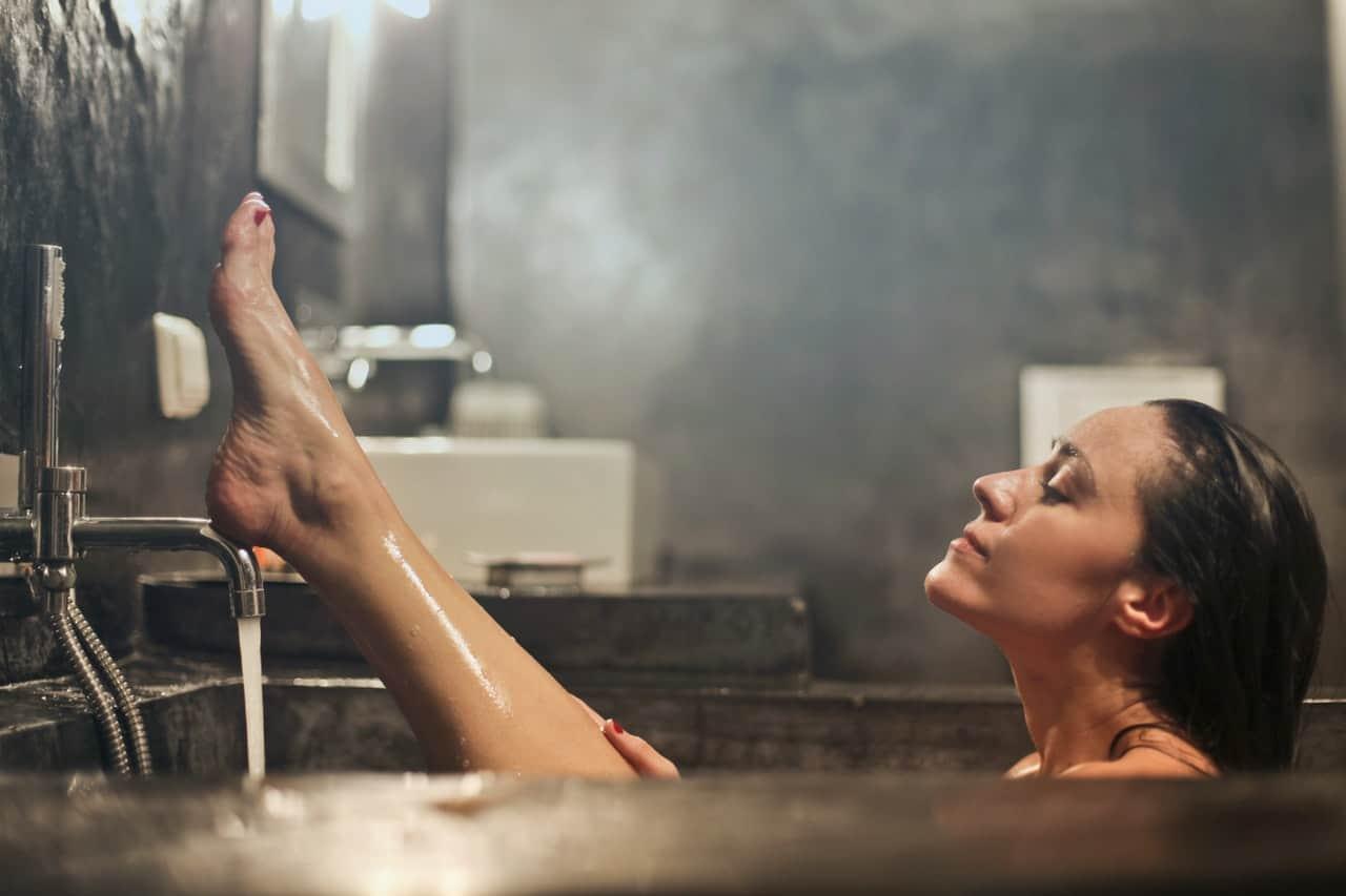 Woman shaving before fake tan
